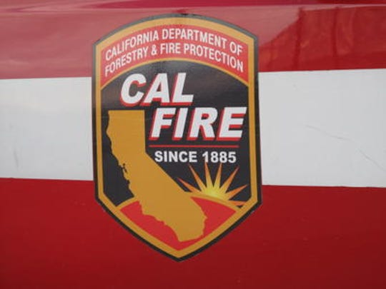 Cal Fire crews are battling  a wildfire off Highway 60. Westbound traffic is blocked.
