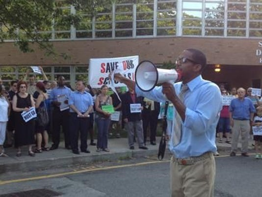 The Rev. Weldon McWilliams IV leads a rally calling for the East Ramapo school district to fire its controversial attorneys on July 8, 2013, at the district offices in Spring Valley. (Photo by Mareesa Nicosia/The Journal News)