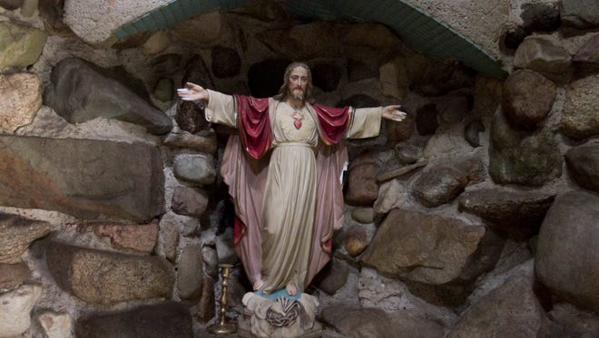 Religious artifacts such as this devotional statue of Jesus Christ found in the lighthouse and left by the builder of the home on Van Amberg Road are preserved by the present owners. The house was opened to the Livingston Daily for a tour Tuesday, Oct. 3, 2017.