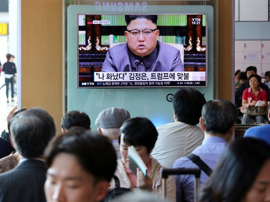 """People watch a TV screen showing an image of North Korean leader Kim Jong Un delivering a statement in response to U.S. President Donald Trump's speech to the United Nations, in Pyongyang, North Korea, at the Seoul Railway Station in Seoul, South Korea, Friday, Sept. 22, 2017. Kim, in an extraordinary and direct rebuke, called U.S. President Donald Trump """"deranged"""" and said he will """"pay dearly"""" for his threats, a possible indication of more powerful weapons tests on the horizon.The signs read """"I was angry."""" (AP Photo/Ahn Young-joon)"""