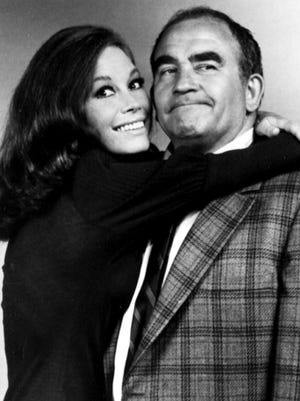 Mary Tyler Moore and  Ed Asner.