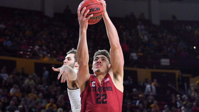 Mar 3, 2018; Tempe, AZ, USA; Stanford Cardinal forward Reid Travis (22) goes up for a layup against Arizona State Sun Devils forward Mickey Mitchell (3) during the first half at Wells-Fargo Arena.