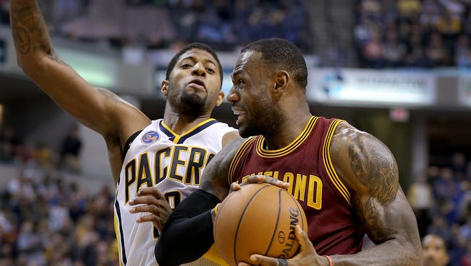 Cleveland Cavaliers forward LeBron James (23) drives on Indiana Pacers forward Paul George (13) in the second half of their game Monday, Feb 1, 2016, evening at Bankers Life Fieldhouse. The Indiana Pacers lost to the Cleveland Cavaliers 106-111.