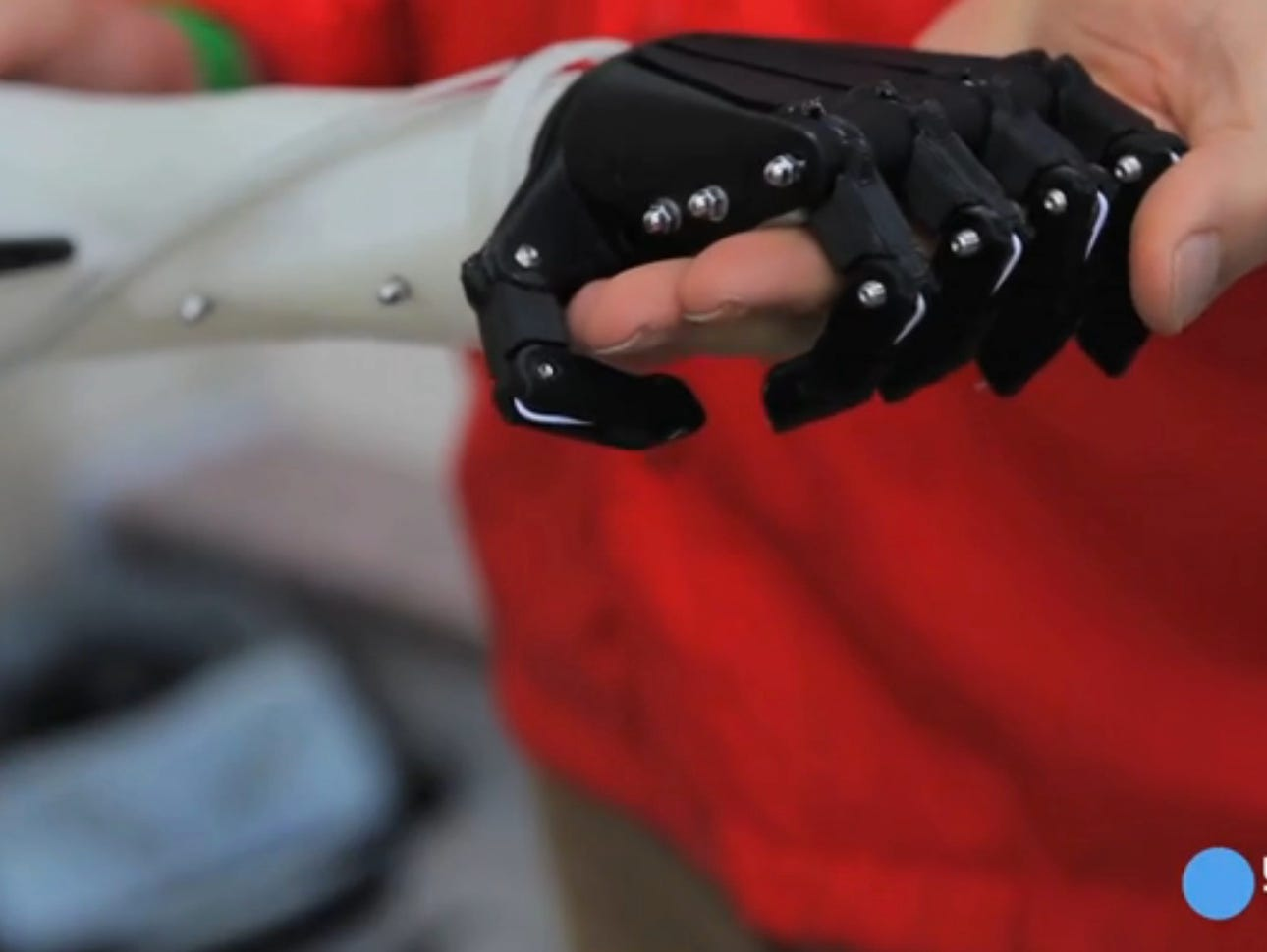 A copy of the prosthetic arm made with a 3D printer for $100 by nonprofit Not Impossible.