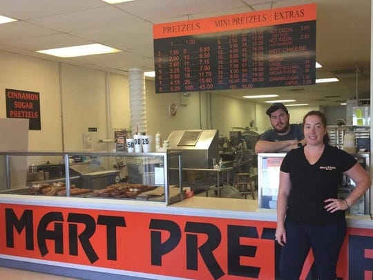 Sandy Frazer stands in her family's business, The Original Mart Pretzel Bakery, which moved to Cinnaminson after demolition of the Pennsauken Mart.