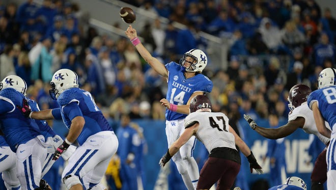 UK QB Patrick Towles throws an interception during the first half of the University of Kentucky - Eastern Kentucky University football game at Commonwealth Stadium in Lexington, Ky., on Saturday, October 3, 2015.