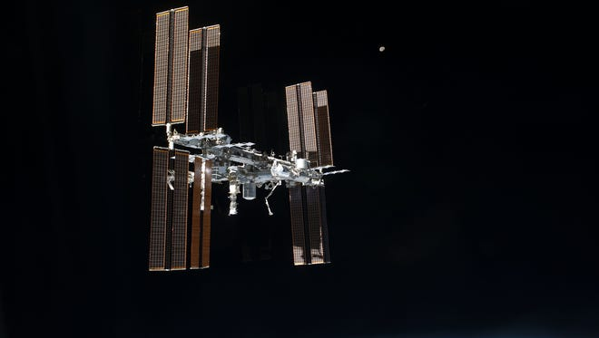 The International Space Station was photographed from the space shuttle Atlantis as a shuttle departed the orbiting complex for the final time in the early hours of July 19, 2011.