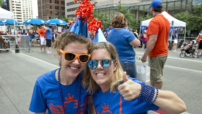 Thousands of FC Cincinnati Soccer fans gathered on Fountain Square on Tuesday, May 29, 2018 to watch a live broadcast from Rhinegeist Brewery announcing that the team was accepted into Major League Soccer. Katherine and Barbara Koplyay of Edgewood wore their party hats for the occasion.