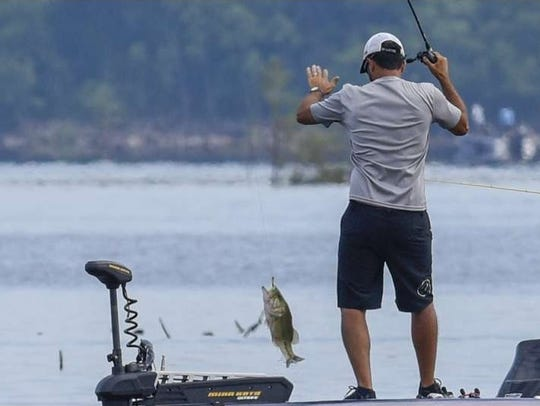 Bossier City's Nick LeBrun lands a fish during Thursday's