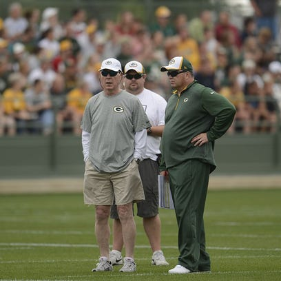 Green Bay Packers general manager Ted Thompson and head coach Mike McCarthy look on during training camp practice at Ray Nitschke Field on Saturday, July 26, 2014.