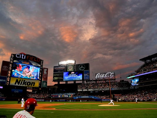 New York Mets pitcher Jacob deGrom (48) warms up for the fifth inning of the team's baseball game against the Philadelphia Phillies, Friday, June 30, 2017, in New York. (AP Photo/Julie Jacobson)