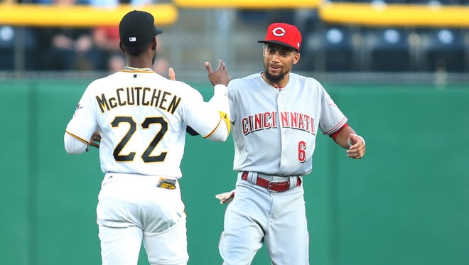 Apr 10, 2017; Pittsburgh, PA, USA;  Pittsburgh Pirates right fielder Andrew McCutchen (22) and Cincinnati Reds center fielder Billy Hamilton (6) greet each other in the outfield before their game at PNC Park. Mandatory Credit: Charles LeClaire-USA TODAY Sports