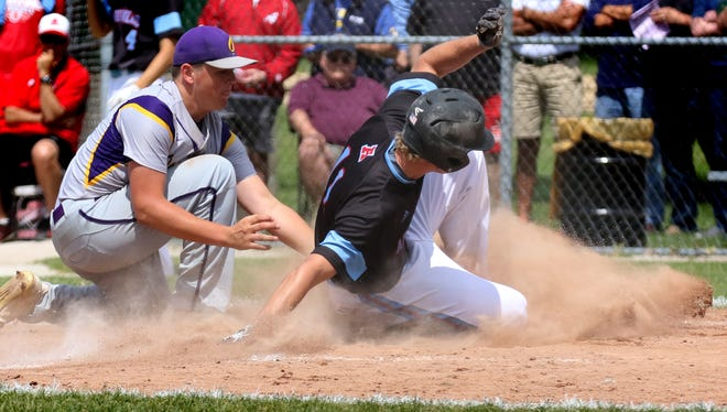 Arrowhead's Chandler Pulvermacher skids in safe at home against Oconomowoc's Miller Wallace during WIAA sectional semifinal play at Oconomowoc on June 5.