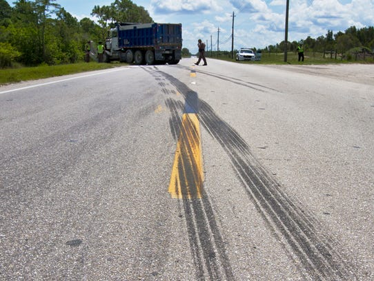 A fatal two-vehicle crash leaves eastbound Alico Road