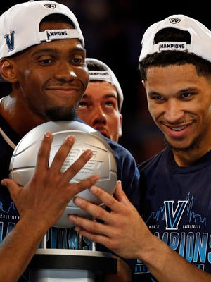 Villanova Wildcats forward Darryl Reynolds (45) and Villanova Wildcats guard Josh Hart (3) hold the championship trophy after defeating the Creighton Bluejays in the Big East Conference Tournament final game at Madison Square Garden.