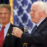 "Sen. John McCain, R-Ariz., right, is standing by his comment that Sen. Jeanne Shaheen, D-N.H., is not a ""serious member"" of the Senate Armed Services Committee. McCain is backing Shaheen's Republican opponent Scott Brown, left."