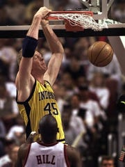 5/23/99 --- Pacers Rik Smits slams against 76ers Tyrone