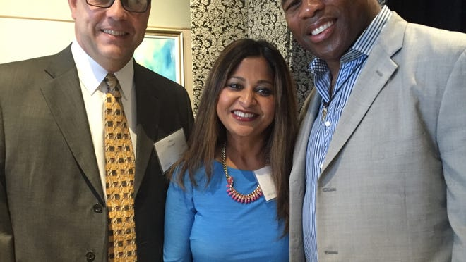 Sitima and Mike Fowler at a luncheon with Herschel Walker