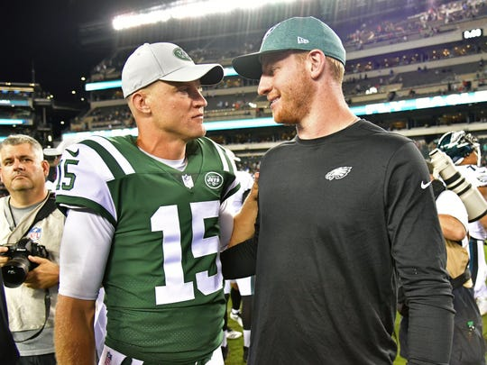 New York Jets quarterback Josh McCown (15) and Philadelphia Eagles quarterback Carson Wentz (11) meet on the field after the game at Lincoln Financial Field Thursday, Aug. 30, 2018.
