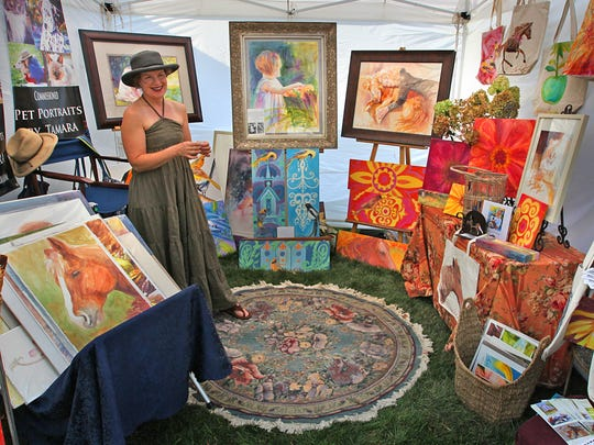 Louisville, Kentucky, artist, Tamara Scantland Adams, with her work, during the first ever, An Evening With Penrod (Pre-Penrod Art Fair Event) on the grounds of the Indianapolis Museum of Art. Frank Espich/The Star