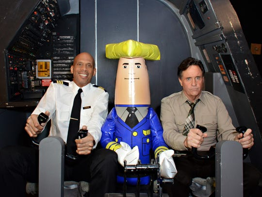 """""""Roger Murdock"""" (Kareem Abdul-Jabbar), """"Ted Striker"""" (Robert Hays) and Otto Pilot in the original """"Airplane!"""" cockpit during the shoot of aerial ads for the Wisconsin Department of Tourism."""