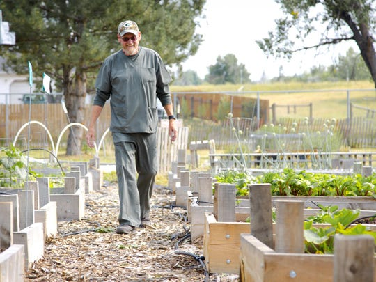 John Nelson, a volunteer at West Side Orchard Garden,