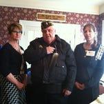 Pictured are Carol Vleeshouwers, program chairwoman, from left, Dennis Aldrich, speaker, and Michele Abler, regent.