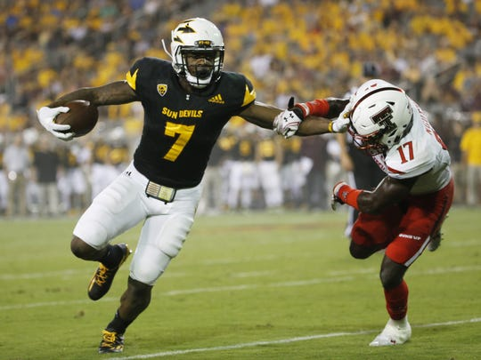ASU running back Kalen Ballage (7) fends off Texas