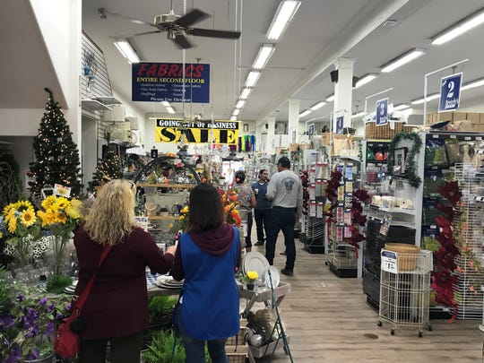 Shops take advantage of the going out of business sale at Beverly Fabrics, Salinas