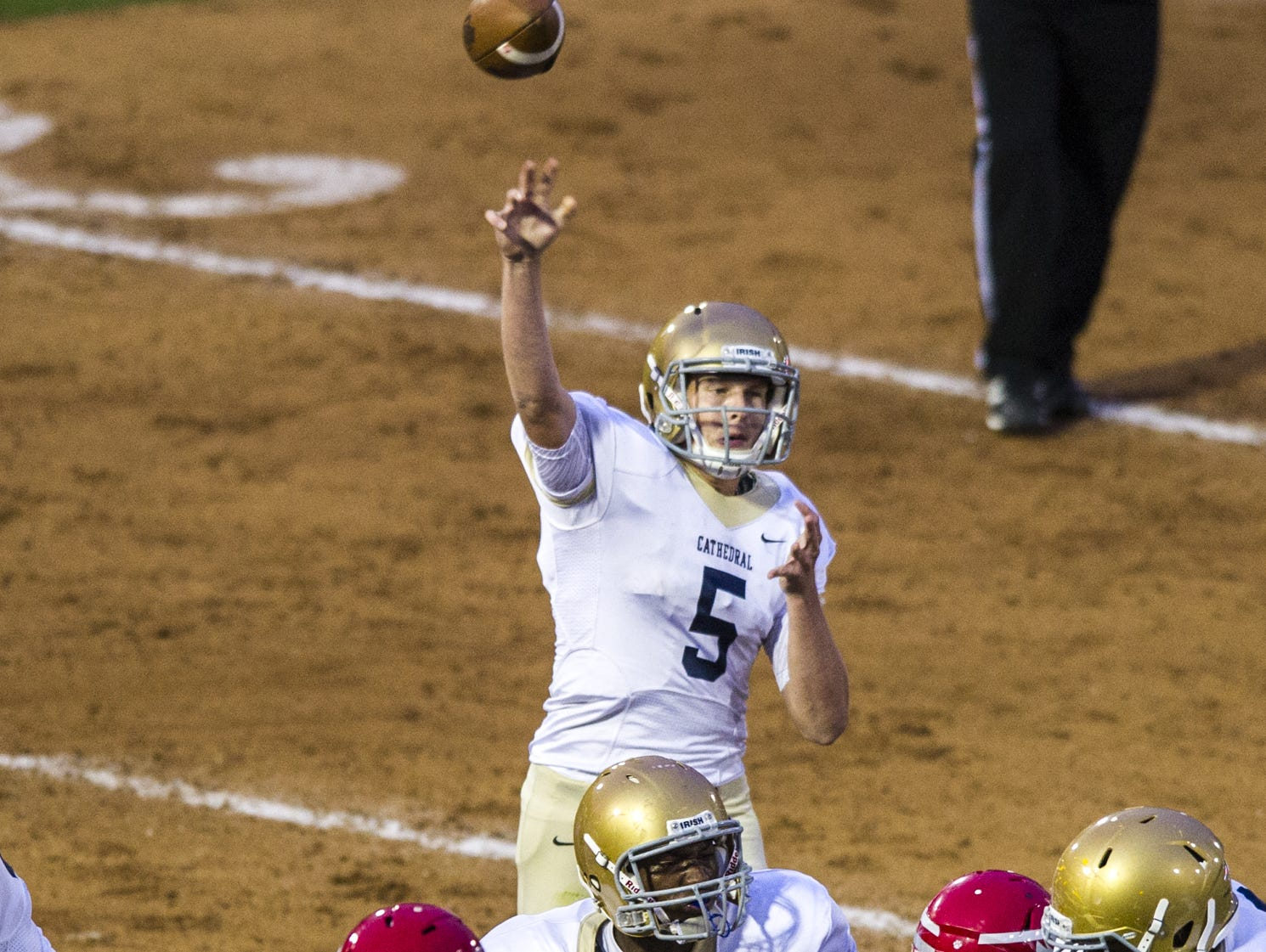Cathedral High School senior quarterback Max Bortenschlager (5) passes the ball out of the backfield during the first half of action of an inaugural IHSAA varsity football game being played at Victory Field in Indianapolis, Friday, October 2, 2015.