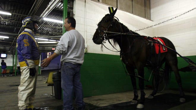 In this file photo, driver Mike Sorentino Jr., left, talks with trainer Sean Campbell before racing with My Boss Lady at Yonkers Raceway. Campbell was one of six trainers suspended by the state Gaming Commission for having horses which tested positive for high levels of cobalt.