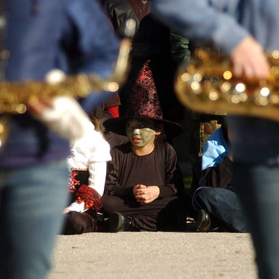 Katrina Yang, a third-grader at Hales Corners Elementary School, listens to the Whitnall High School marching band perform Wednesday, Oct. 29, 2008, at Hales Corners Elementary School.