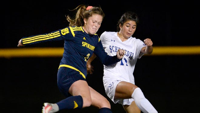Spencerport's Erin Coykendall, left, winds up a shot on goal while defended by Webster Schroeder's Mikayla Morelli during Tuesday's match at Schroeder. Coykendall had two goals and an assist.