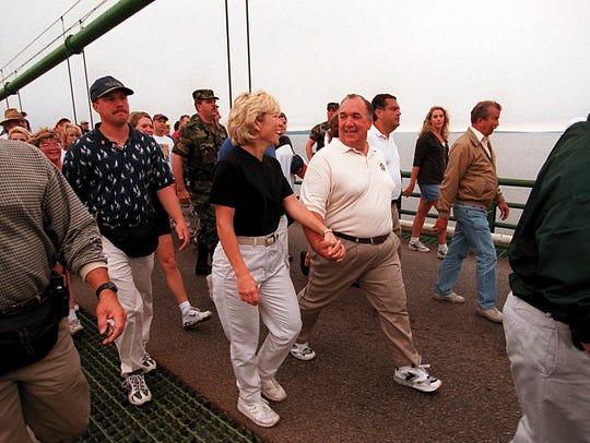 Gov. John Engler of Michigan jokes with his wife Michelle