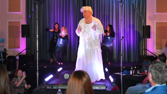 Bob Gabordi, executive editor at FLORIDA TODAY dressed as Eva Peron to raise funds for the Women's Center. The 2017 Dude Looks Like a Lady event was held at the Radisson Resort at the Port to fight against domestic violence and other issues. Ten Brevard men, and Master of Ceremonies Sheriff Wayne Ivey, dressed up as famous female celebrities to bring in over $150,000, and counting to the cause.