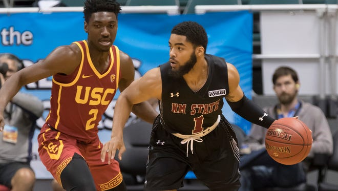 New Mexico State guard Shunn Buchanan (1) attempts to drive around Southern California guard Jonah Mathews (2) during the first half of an NCAA college basketball game at the Diamond Head Classic, Monday in Honolulu.