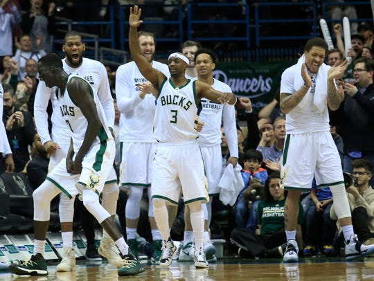 The Milwaukee Bucks react after a defensive play against