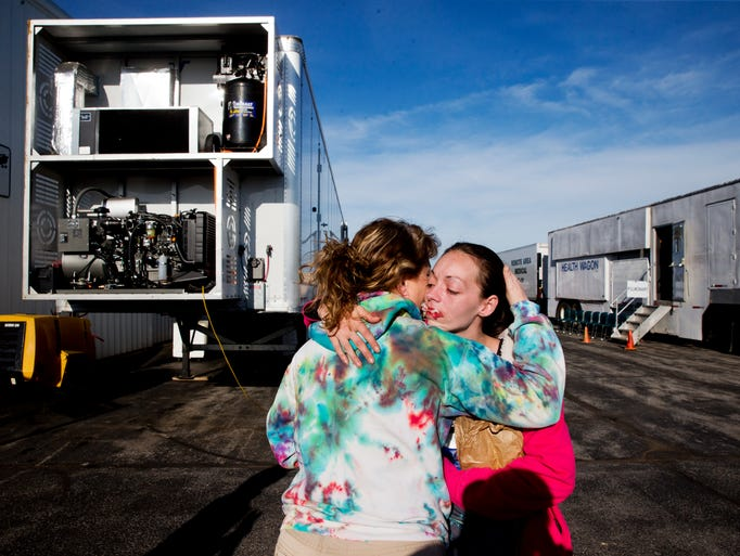 Monica Hicks, of Meadowview, Va., left, hugs her daughter