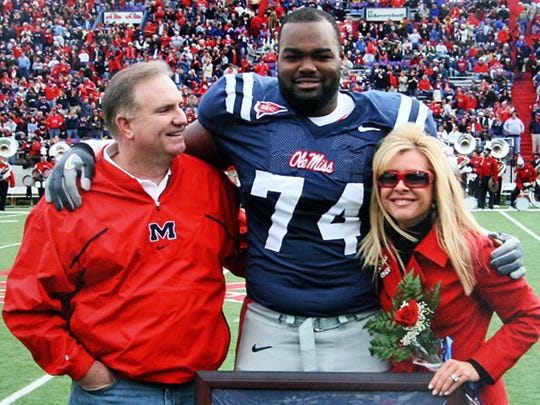 An undated family photo of Michael Oher with Sean and Leigh Anne Tuohy at an Ole Miss game.