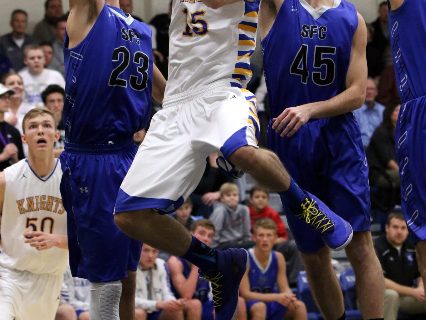 Joey Messler of O'Gorman gets past several SF Christian defenders to put a shot during Tuesday's game at O'Gorman.