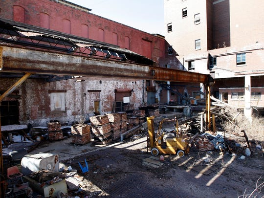 The former Hudepohl Brewery on Linn Street downtown sits vacant and dilapidated.
