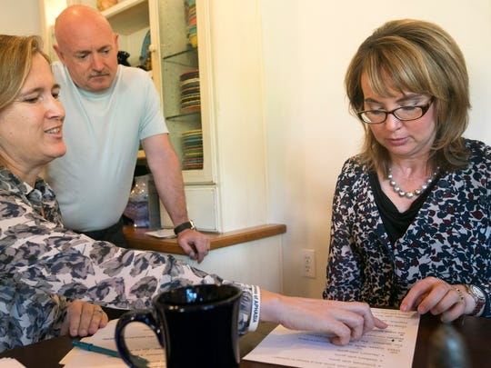 Gabby Giffords works with speech pathologist Fabi Hirsch during a speech therapy session at Giffords' home in Tucson on Sept. 23, 2014.