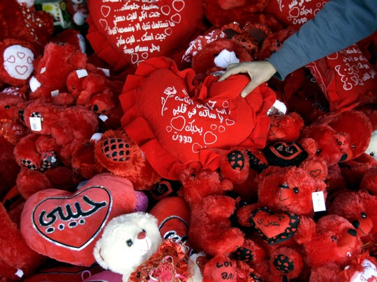 A Palestinian vendor decorates his shop with gifts for Valentine's Day in the West Bank city of Jenin, Thursday, Feb. 13, 2014. (AP Photo/Mohammed Ballas). ORG XMIT: MB101