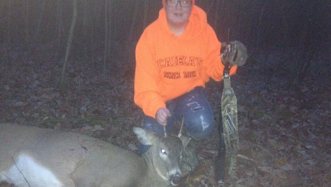 Alex Vandenhouten of Potter shows his spike buck that he shot near Porterfield in southern Marinette County. This was Alex's first buck, and it tipped the scale at 118 pounds.