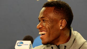 Xavier Musketeers guard Quentin Goodin laughs as head coach Chris Mack cracks jokes in his answers during a media day press conference ahead of Xavier's Elite 8 game with the 1-seed Gonzaga at the SAP Center in San Jose, Calif., on Friday, March 24, 2017. Xavier advanced to the Elite 8 with a 73-71 upset win over the 2-seeded Arizona Wildcats.