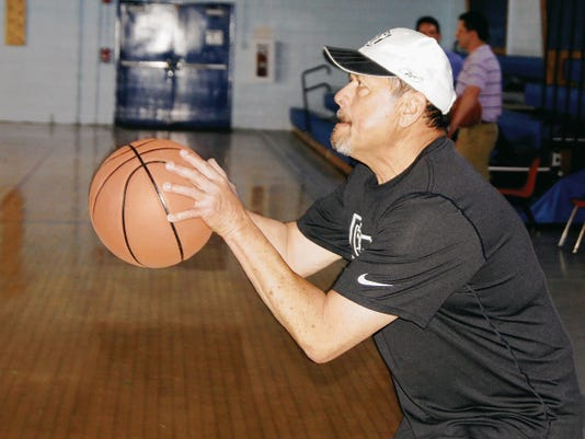 Ronald Quintana concentrates on his shot during Wednesday night's Senior Olympics 3-point shot basketball competitions, held at GW Stout Elementary in Silver City. Senior games continue on Saturday with the cycling competition. For information about the cycling event, call Lynn Mondello at 575-313-4766.  Randal Seyler - Sun-News