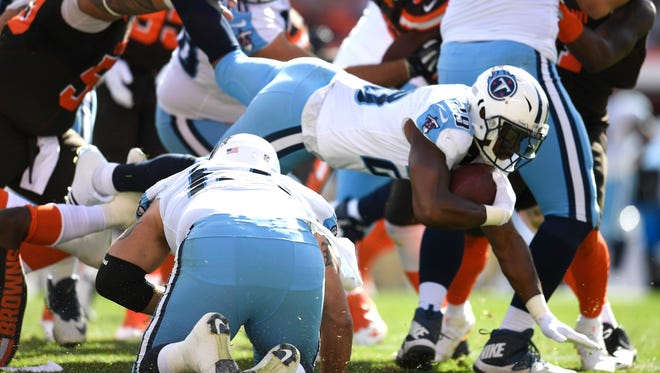Titans running back DeMarco Murray (29) gets tripped up in the backfield during the second quarter Sunday.