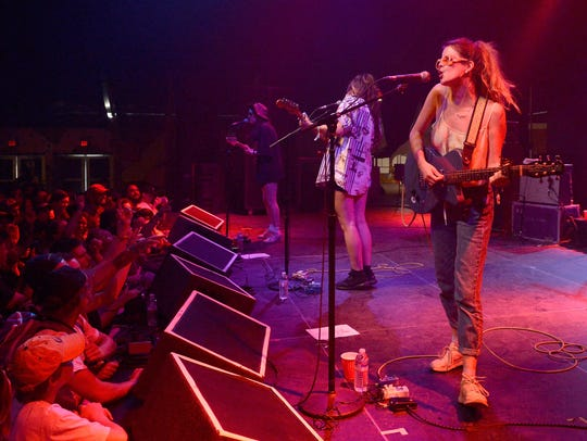 Ade Martin and Carlotta Cosials of Hinds performs in