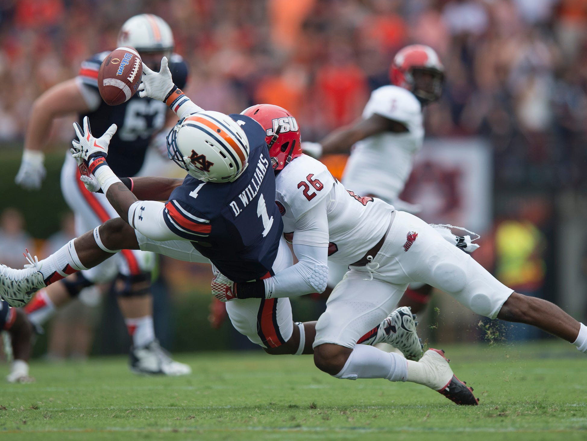 Auburn Tigers wide receiver D'haquille Williams (1) drops a pass as Jacksonville State Gamecocks safety Santavious Oden (26) hits him during the first half of the NCAA Auburn vs. Jacksonville State on Saturday, Sept. 12, 2015, in at Jordan-Hare Stadium in Auburn, Ala. Albert Cesare / Advertiser