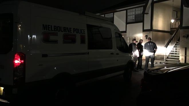 Melbourne police officers and CSI officials at the scene of the shooting at English Park apartment complex in melbourne.